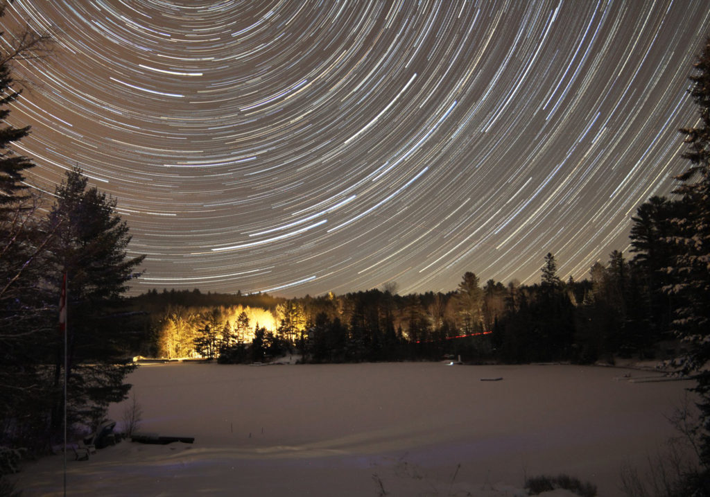Star Trails over a frozen lake at the cottage