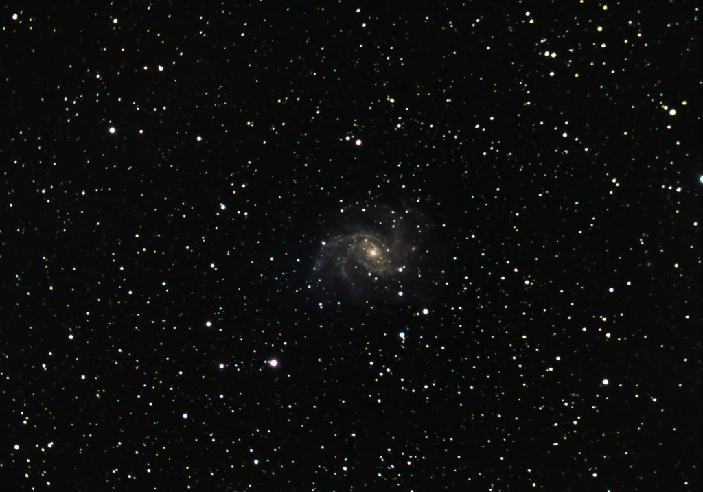 NGC The Fireworks Galaxy, photographed with a near full moon