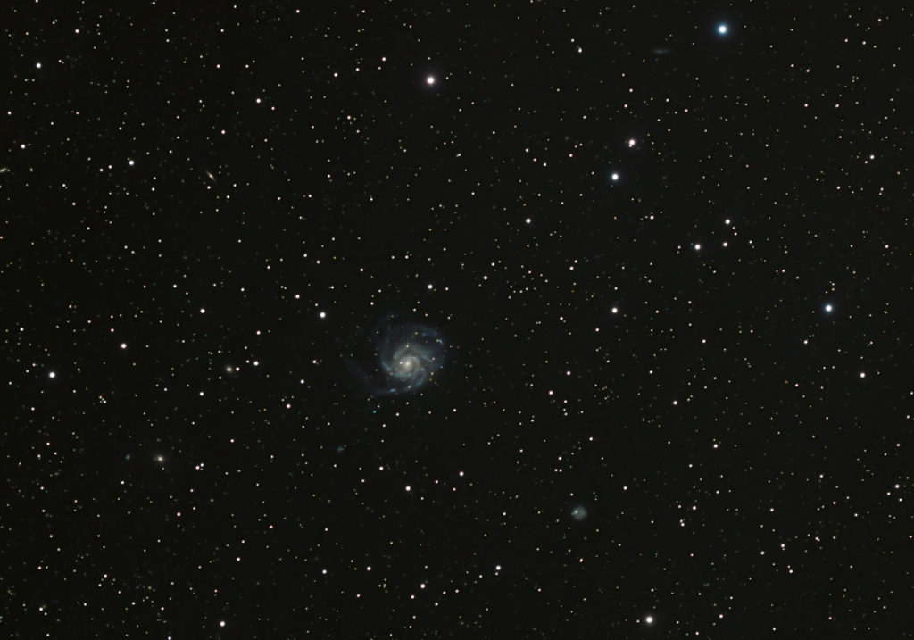 Widefield astrophotography image of galaxy Messier 101, the Pinwheel Galaxy. Taken by an amateur astrophotographer in June 2020.