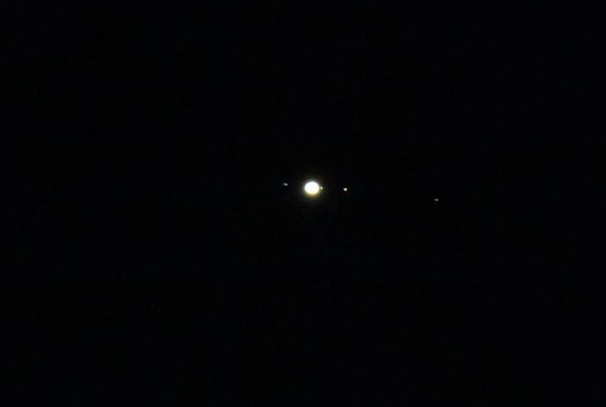 Jupiter and several of its moons, photographed in July 2016